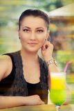 Young Woman with Colorful Cocktail Drink Outside Royalty Free Stock Photo