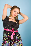 Young woman in colorful dress Stock Images