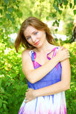 Young woman in colorful dress Stock Photo