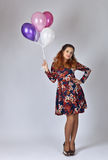 Young woman in colorful dress with balloons Royalty Free Stock Image