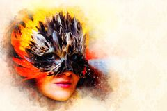 Young woman with a colorful feather carnival face mask and ornaments and softly blurred watercolor background. Royalty Free Stock Images