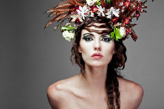 Young woman with colorful flowers in hair. Royalty Free Stock Photos
