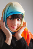 Young woman in colorful head scarf Royalty Free Stock Image