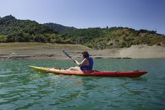 Young woman rowing in a kayak royalty free stock photos