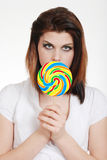 Young woman with colorful lollipop Stock Photography