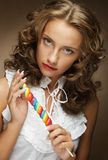 Young woman with colorful lollipop Royalty Free Stock Photo