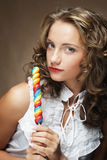 Young woman with colorful lollipop Stock Image
