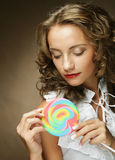 Young woman with colorful lollipop Royalty Free Stock Photography