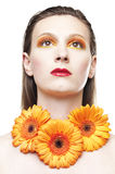 Young woman with colorful make-up and gerbera Royalty Free Stock Photos
