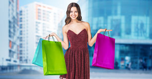 Young woman with colorful packages Stock Photo