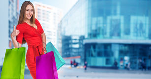 Young woman with colorful packages Royalty Free Stock Images