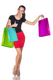 Young woman with colorful packages Royalty Free Stock Image