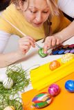 Young woman with colorful painted eggs for easter Stock Images