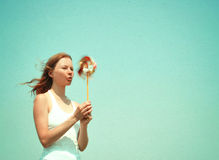 Young woman with a colorful pinwheel royalty free stock photography