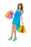 Young woman with colorful shopping bags Royalty Free Stock Photos
