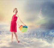 Young woman with colorful shopping bags Stock Photo