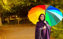 Young woman with colorful umbrella Royalty Free Stock Photo
