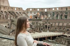 Young woman in Colosseum, Rom stock photo