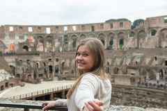 Young woman in Colosseum, Rom stock photos