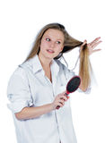 Young woman with comb Royalty Free Stock Photography