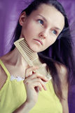 Young woman with comb Stock Image