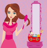 Young woman combing hair. Vector Illustration Stock Photography