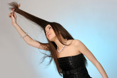 Young woman combing her hair Royalty Free Stock Photo