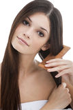 Young woman combing her hair Stock Image
