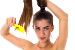 Young woman combing her long ponytail Stock Images