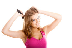 Young woman combs hair Royalty Free Stock Photo