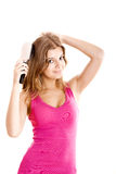Young woman combs hair Royalty Free Stock Photos