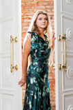Young woman comes out of the door Royalty Free Stock Photo