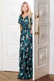 Young woman comes out of the door Royalty Free Stock Image