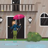 Young woman comes out of the house with an umbrella  Royalty Free Stock Photo