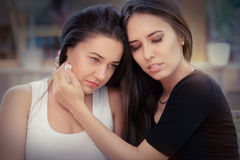 Young woman comforting tearful friend Royalty Free Stock Photo