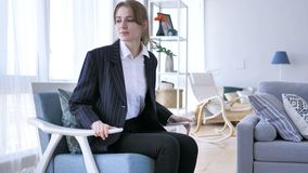 Young Woman Coming To Room and Sitting on Sofa. 4k , high quality stock footage