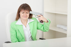Young woman commits suicide on workplace at office Royalty Free Stock Photography