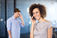 Young woman communicating on mobile phone Stock Photo