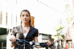 Young woman commuting on bicycle Stock Photography