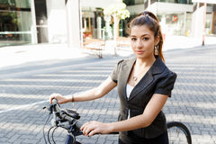 Young woman commuting on bicycle Stock Images