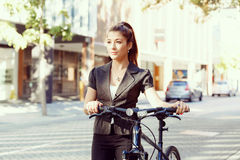 Young woman commuting on bicycle Royalty Free Stock Image