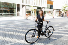 Young woman commuting on bicycle Royalty Free Stock Photos