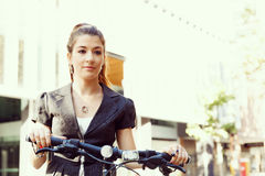 Young woman commuting on bicycle Royalty Free Stock Photography