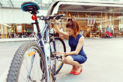 Young woman commuting on bicycle Stock Photo