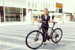 Young woman commuting on bicycle Royalty Free Stock Photo