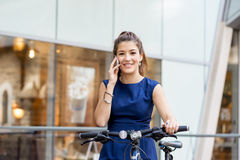 Young woman commuting on bicycle Royalty Free Stock Images