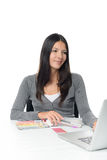 Young woman comparing colors online Royalty Free Stock Photo