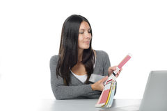 Young woman comparing colors online Stock Images