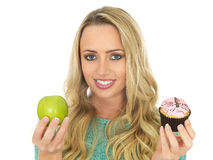Young Woman Comparing Good and Bad Food Stock Photography
