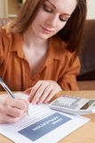 Young Woman Completing Loan Application Form Stock Photos